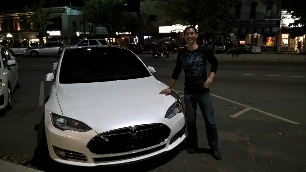 Felix with Chris' white Tesla.